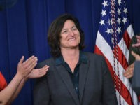 Patagonia CEO Rose Marcario receives applause after being acknowledge by US President Barack Obama during an event highlighting important middle class issues on April 16, 2015 in the South Court Auditorium of the Eisenhower Executive Office Building, next to the White House, in Washington, DC. AFP PHOTO/MANDEL NGAN (Photo credit …