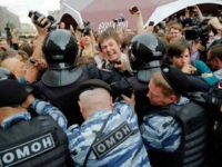 Protestors are blocked by riot police during a demonstration in downtown Moscow, Russia, on Monday.