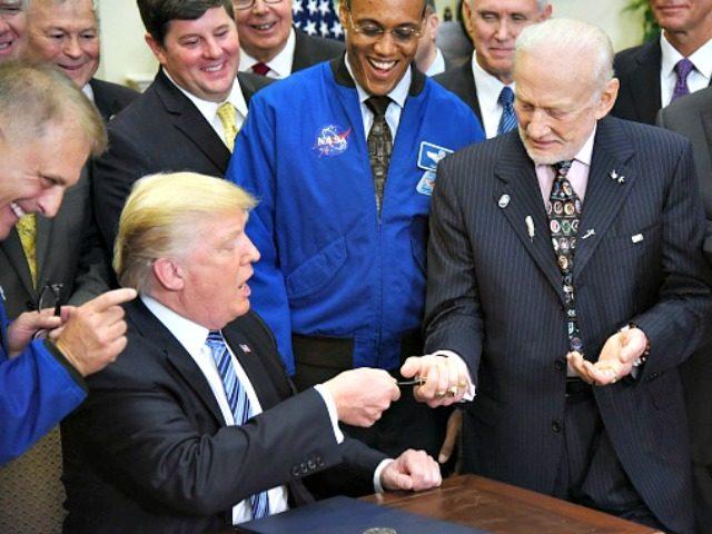 Trump, Aldrin, Olivier DoulieryAFP