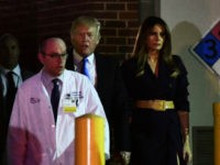 Dr. Ira Rabin (L) escorts US President Donald Trump and First Lady Melania Trump from MedStar Washington Hospital Center on June 14, 2017 in Washington, DC, after visting Republican Congressman Steve Scalise, critically wounded in a shooting at a charity baseball event. Trump and the First Lady brought flowers to the hospital in northeast Washington where the lawmaker was recovering after surgery following the shooting in nearby Virginia, the White House said. / AFP PHOTO / Nicholas Kamm (Photo credit should read NICHOLAS KAMM/AFP/Getty Images)