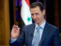 FILE - In this Feb. 10, 2015, file photo released by the Syrian official news agency SANA, Syrian President Bashar Assad gives an interview with the BBC in Damascus, Syria. On Wednesday, March 30, 2016, Assad said in an interview with Sputnik, a Russian state news agency, that Syria needs …