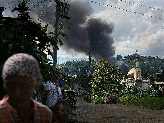 MARAWI CITY, PHILIPPINES - MAY 30: Smoke billows from the city center after an air attack by Philippine government troops on May 30, 2017 in Marawi city, southern Philippines. Philippine government troops are battling their way as they inch towards the city center where ISIS-linked militants have been holed for …