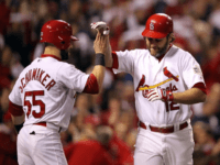Lance Berkman #12 of the St. Louis Cardinals celebrates with Skip Schumaker #55 after hitting a two-run home run in the first inning during Game Six of the MLB World Series against the Texas Rangers at Busch Stadium on October 27, 2011 in St Louis, Missouri.