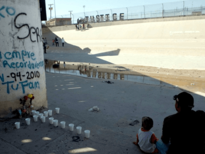 Relatives of Sergio Hernández sit in Ciudad Juarez at the U.S.-Mexico border, on the second anniversary of his killing in 2012. Jesus Alcazar/AFP/Getty Images