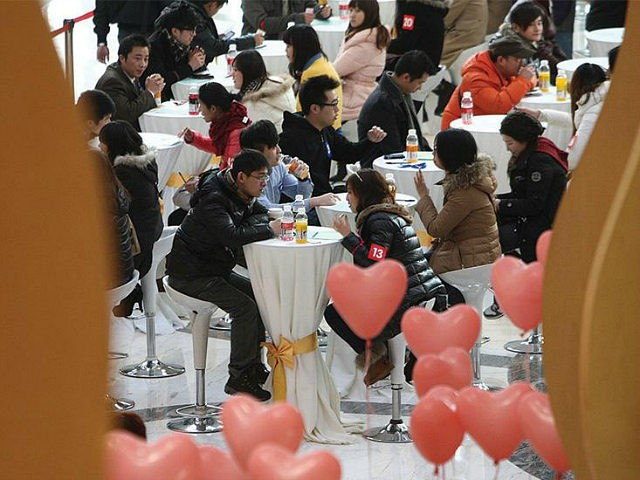 SHANGHAI, CHINA - FEBRUARY 11: (CHINA OUT) Men and women gather during a 'singles fair' as they look for potential partners at Joy City on February 11, 2012 in Shanghai, China. Preparations for Valentine's Day begin around China after the Spring Festival. (Photo by VCG/VCG via Getty Images)