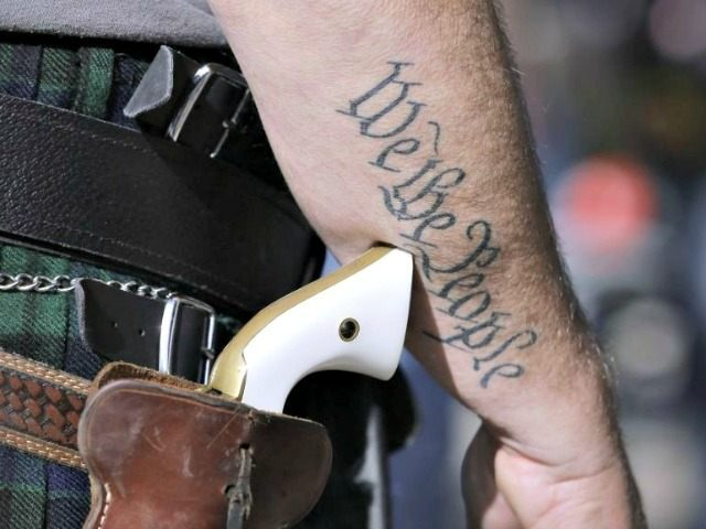 FILE - In this Jan. 26, 2015 file photo, a supporter of open carry gun laws, wears a pistol as he prepares for a rally in support of open carry gun laws at the Capitol, in Austin, Texas. Texas is still sorting out where firearms are allowed, and where they're …