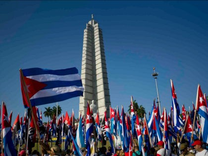 People march with Cuban flags during the May Day parade at Revolution Square in Havana, Cuba, Monday, May 1, 2017. (AP Photo/Ramon Espinosa)