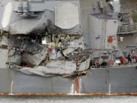 In this June 18, 2017 file photo, damaged section of the USS Fitzgerald is seen at the U.S. Naval base in Yokosuka, southwest of Tokyo. The U.S. Navy has identified the seven sailors who died when their destroyer collided with a container ship off Japan on Saturday.(AP Photo/Eugene Hoshiko, File)