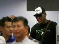 Former NBA basketball star Dennis Rodman, right, is seen in a security queue at Beijing's International Airport's terminal 2 on Tuesday, June 13, 2017, in Beijing, China. North Korea is expecting another visit by former NBA bad boy Rodman on Tuesday in what would be his first to the country …