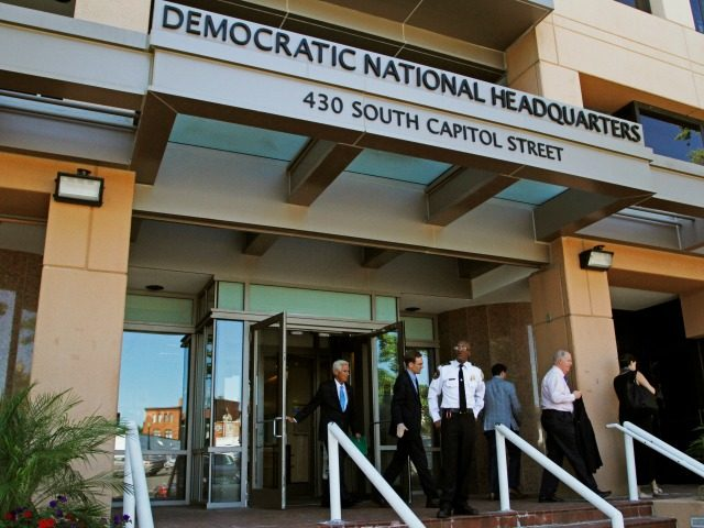 In this June 14, 2016 file photo, people stand outside the Democratic National Committee (DNC) headquarters in Washington. The computers of the House Democratic campaign committee have been hacked, an intrusion that investigators say resembles the recent cyber breach of the Democratic National Committee for which the Russian government is …