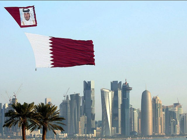DOHA, QATAR - DECEMBER 18: Qatar Air Forces unfurl the flag of Qatar during the 137th anniversary celebrations of the Qatar's National Day in Doha, Qatar on December 18, 2015. Thousands of people have gathered along Doha's waterfront to celebrate Qatar's National Day. The annual holiday marks the date in …