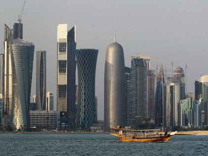 FILE - In this Thursday Jan. 6, 2011 file photo, a traditional dhow floats in the Corniche Bay of Doha, Qatar, with tall buildings of the financial district in the background. Qatar, now facing a diplomatic crisis with other Arab nations, is a small country with a big history of …