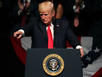 MIAMI, FL - JUNE 16: U.S. President Donald Trump points as he speaks about policy changes he is making toward Cuba at the Manuel Artime Theater in the Little Havana neighborhood on June 16, 2017 in Miami, Florida. The President will re-institute some of the restrictions on travel to Cuba …