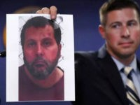 Timothy Wiley, FBI public affairs specialist, holds a photo Amor Ftouhi after a news conference in Detroit, Thursday, June 22, 2017. Amor Ftouhi, a Canadian man, shouted in Arabic before stabbing a police officer in the neck at the Bishop International Airport in Flint, Mich., on Wednesday, and referenced people …