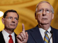 In this May 23, 2017, file photo, Senate Majority Leader Mitch McConnell of Ky., right, accompanied by Sen. John Barrasso, R-Wyo., speaks on Capitol Hill in Washington. The Republican effort to secretly craft a health care bill and whisk it through the Senate is striking, and it's drawing fire from …