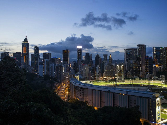 The Hong Kong Jockey Club's Happy Valley racecourse sits surrounded by buildings at dusk in Hong Kong, China, on Wednesday, June 7, 2017. One of the city's most-venerable institutions, the Hong Kong Jockey Club, which has been called an 'ATM for the government' for its huge contributions to the city's …