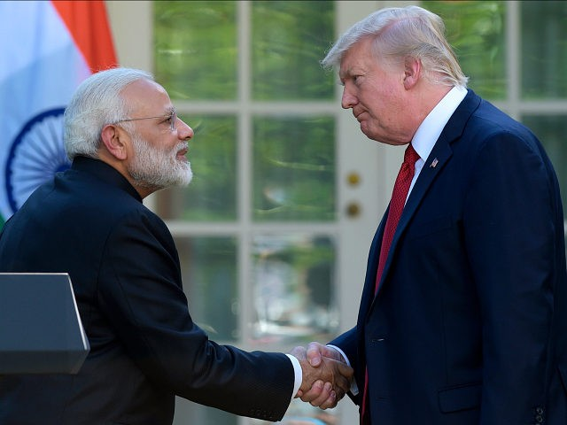 Donald Trump Looks Exceptionally Uncomfortable Hugging Narendra Modi
