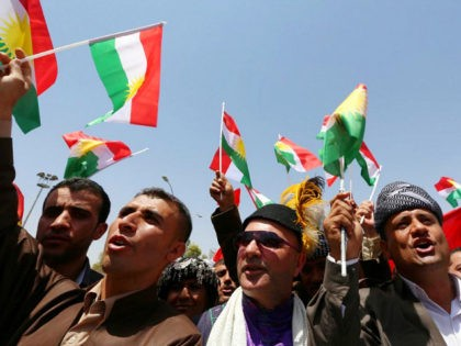 Iraqi Kurds protest and wave flags of their autonomous Kurdistan region during a demonstration to claim for its independence on July 3, 2014 outside the Kurdistan parliament building in Arbil, in northern Iraq. The Kurdish leader, Massud Barzani asked its parliament to start organizing a referendum on independence. AFP PHOTO …
