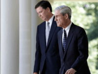 WASHINGTON, DC - JUNE 21: James Comey (L) FBI Director nominee walks with outgoing FBI Director Robert Mueller (R) to a ceremony annoucing Comey's nomination in the Rose Garden at the White House June 21, 2013 in Washington, DC. Comey, a former Justice Department official under President George W. Bush, would replace Mueller. (Photo by Win McNamee/Getty Images)