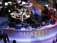 A general view shows the newsroom at the headquarters of the Qatar-based Al-Jazeera satellite channel in Doha 14 November 2006. The English-language version of Al-Jazeera's launches 15 November 2006 after a year-long delay. The pan-Arab TV station is out to capitalise on the strategic importance of London as a European capital when it kicks off its English-language service tomorrow. AFP PHOTO/KARIM JAAFAR KARIM JAAFAR / AFP