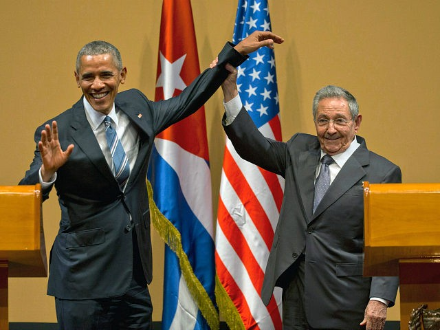 FILE - In this March 21, 2016 file photo, Cuban President Raul Castro, right, lifts up the arm of U.S. President Barack Obama, at the conclusion of their joint news conference at the Palace of the Revolution, in Havana, Cuba. Next year will likely be Castro's toughest year in office …