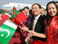 Chinese nationals carry Pakistani and Chinese flags during Chinese President Hu Jintao arrival at Allama Iqbal International airport in Lahore, 25 November 2006. Chinese President Hu Jintao received a warm welcome in the eastern Pakistani city of Lahore where he arrived for cultural and business visits after concluding a free …