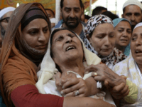 Mohammed Ayub Pandith's relatives mourn his killing. Image credit: Tauseef Mustafa/AFP
