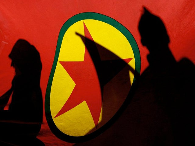 ** FILE ** In this Nov. 12, 2007 file picture, Kurdish demonstrators are silhouetted by a Kurdistan Workers' Party (PKK) flag during a protest in the Cypriot capital of Nicosia. Kurdish rebels have kidnapped three German climbers on Mount Ararat, the governor of a province in eastern Turkey said Wednesday …