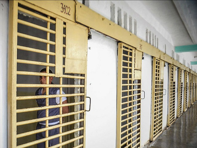 A Cuban inmate remains in his cell at the maximum security 'Combinado del Este' prison, in Havana, on April 9, 2013. Cuban authorities organized a visit for the international media --the only one in the last nine years-- to the biggest prison in Cuba, to show the press the prison …