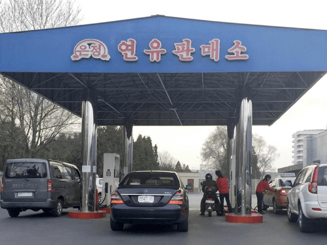 Cars line up at a gas station in Pyongyang, North Korea Credit: Eric Talmadge/AP