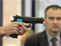 A woman's hand holds a CZ 75 semi-automatic pistol at the booth of Czech firearm producer Ceska Zbrojovka during the International Exhibition of Defence and Security Technologies (IDET) in Brno, Czech Republic on May 22, 2013. The IDET, on of the biggest fairs for defence technology opened on May 22 …