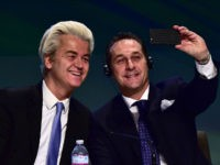 Dutch far-right Freedom Party leader Geert Wilders (L) takes a selfie with Heinz Christian Strache of the Freiheitliche Partei Osterreichs (FPO) during a press conference at the end of the first ENF (Europe of Nations and Freedom) congress in Milan on January 29, 2016. / AFP / GIUSEPPE CACACE (Photo …