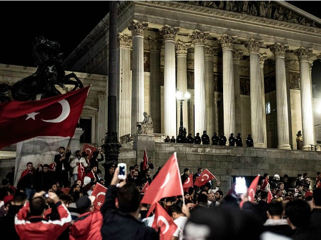 TOPSHOT - Erdogan-supporters demonstrate in front of the parliament in Vienna, Austria, on July 16, 2016, as a military coup attempt against President Recep Tayyip Erdogan was under way. / AFP / APA / CHRISTOPHER GLANZL / Austria OUT (Photo credit should read CHRISTOPHER GLANZL/AFP/Getty Images)