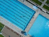 Picture taken with a drone shows bathers swimming at the Kaifu-Bad public pool in Hamburg, northern Germany, where temperatures reached up to 26 degrees Celsius on May 17, 2017. / AFP PHOTO / dpa / Axel Heimken / Germany OUT (Photo credit should read AXEL HEIMKEN/AFP/Getty Images)