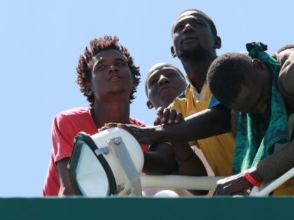 Migrants wait to disembark from the Spanish Guardia Civil Rio Segura Patrol Ship with 1,216 migrants onboard including 256 children and 11 pregnant women, who were rescued in the Mediterranean sea on June 29, 2017, in the port of Salerno. The peak of the migrant crisis in Europe has passed …