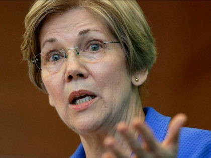 FILE- In this March 27, 2017, file photo, U.S. Sen. Elizabeth Warren, D-Mass., addresses business leaders during a New England Council luncheon in Boston. Warren is slated to deliver the commencement address at Boston's Wheelock College on Friday, May 19. (AP Photo/Steven Senne, File)