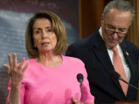 US Senate Minority Leader Chuck Schumer, Democrat of New York, and House Democratic Leader Nancy Pelosi, Democrat of California, speak about US President Donald Trump's Fiscal Year 2018 budget at the US Capitol in Washington, DC, May 23, 2017. / AFP PHOTO / SAUL LOEB (Photo credit should read SAUL …