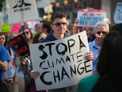 CHICAGO, IL - JUNE 02: Demonstrators protest President Donald Trump's decision to exit the Paris climate change accord on June 2, 2017 in Chicago, Illinois. Yesterday, in a speech from the Rose Garden, Trump announced that the United States would no longer honor the agreement, stating it imposed unfair standards …
