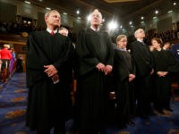 WASHINGTON, DC - JANUARY 28: U.S. Supreme Court Chief Justice John Roberts (L) stands with fellow Justices Anthony Kennedy (2nd from L), Ruth Bader Ginsburg, Stephen Breyer and Elena Kagan (R) prior to President Barack Obama's State of the Union speech on Capitol Hill on January 28, 2014 in Washington, …