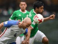 USA's Michael Bradley (L) fights for the ball with Mexico's Oswaldo Alanis during their FIFA World Cup CONCACAF qualifier, in Mexico City, on June 11, 2017