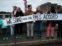 WESTPORT, CT - JUNE 04: Dozens of Connecticut residents converge along a bridge at a vigil and rally for the environment and against President Donald Trump's recent decision to withdraw the United States from the Paris climate accord on June 4, 2017 in Westport, Connecticut. Close to 80 people attended the evening event where critics of the president's environmental policies held candles and sang songs. Trump's decision last week to pull out of the Paris climate agreement has outraged both world leaders and citizens alike. (Photo by Spencer Platt/Getty Images)
