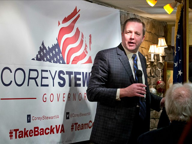 Republican candidate for Governor of Virginia, Corey Stewart, gestures at a campaign kickoff rally at a resturaunt in Occoquan, Va., Monday, Jan. 23, 2017. (AP Photo/Steve Helber)