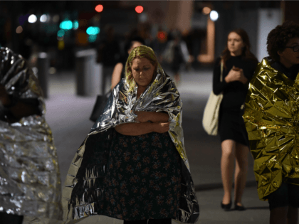 Members of the public, wrapped in emergency blankets leave the scene of a terror attack on London Bridge in central London on June 3, 2017.