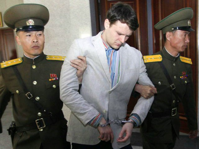 FILE - In this March 16, 2016, file photo, American student Otto Warmbier, center, is escorted at the Supreme Court in Pyongyang, North Korea. Warmbier, whose parents say has been in a coma while serving a 15-year prison term in North Korea, was released and returned to the United States …