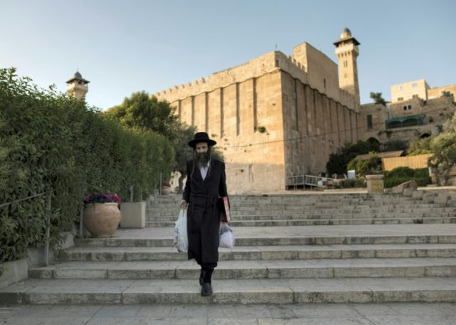 A Jewish man walks outside the Patriarchs' Tomb, known in Arabic as the Ibrahimi Mosque, in the the divided West Bank city of Hebron on May 29, 2017