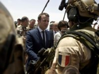 France is attempting to overcome US reservations about financial backing for anti-terrorism forces in the Sahel region of Africa, pictured in May 2017 when French President Emmanuel Macron (C), visited the French troops in northern Mali