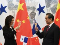 Panama's Foreign Minister Isabel de Saint Malo and Chinese Foreign Minister Wang Yi drink a toast after signing a joint communiqué on establishing diplomatic relations, in Beijing