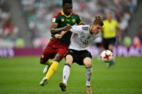 Germany's forward Timo Werner (R) challenges Cameroon's defender Ernest Mabouka during the 2017 FIFA Confederations Cup group B football match June 25, 2017