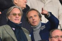 Fiorentina owners Diego (L) and Andrea Della Valle watch the Italian Serie A match against Inter Milan at the Artemio Franchi Stadium in Florence on February 17, 2013