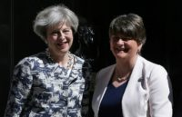 Britain's Prime Minister Theresa May (left) poses for a picture with Democratic Unionist Party (DUP) leader Arlene Foster at 10 Downing Street in central London on June 26, 2017